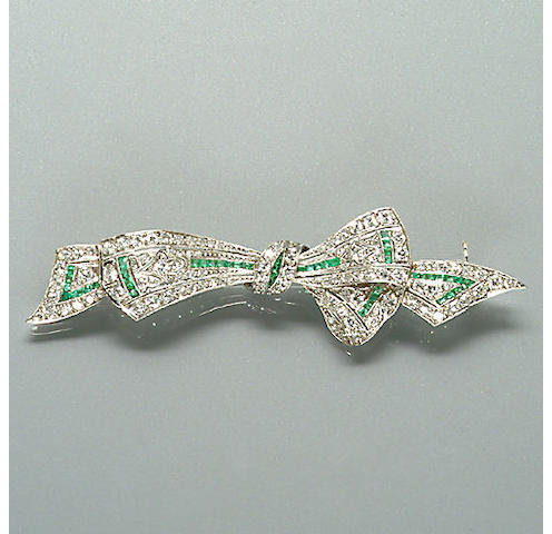 An early 20th century diamond and emerald brooch