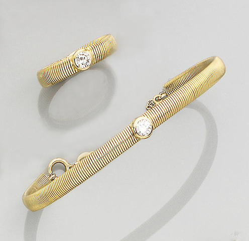 A diamond-set bangle and ring suite (2)