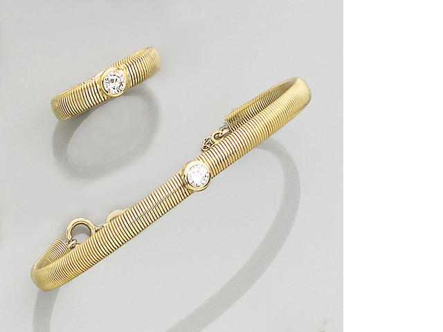 A diamond-set bangle and ring suite,
