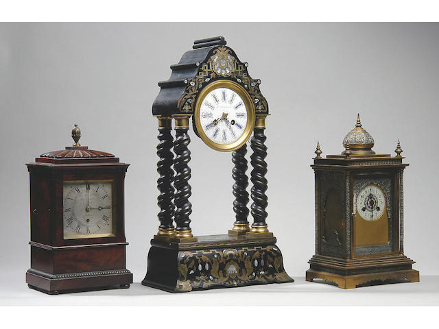 A 19th century brass and silvered mantel clock
