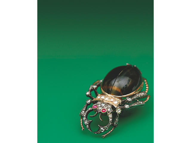 A Victorian gold and silver mounted gem set beetle,