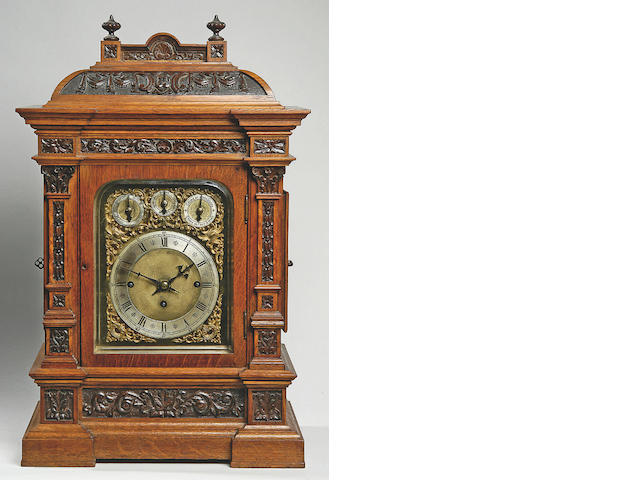 A late 19th century German carved oak bracket clock