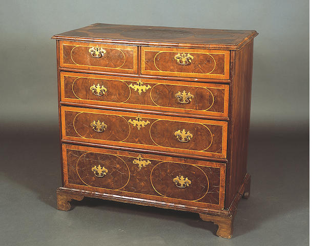 An early 18th Century walnut, fruitwood and oyster work veneered and line inlaid chest,