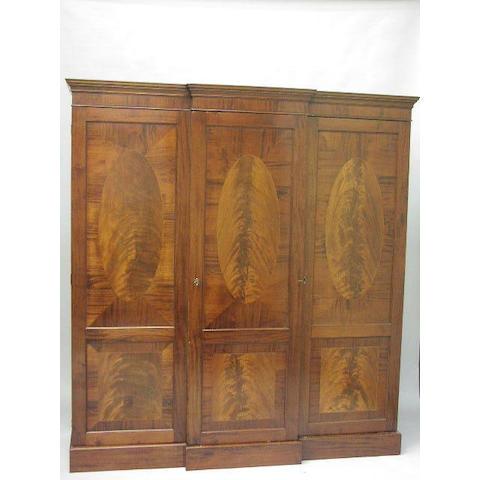 A Regency mahogany and crossbanded breakfront wardrobe