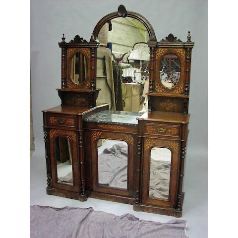 A late Victorian carved walnut and boxwood inlaid chiffonier