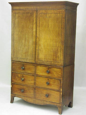 A Regency mahogany and boxwood and ebony strung linen press