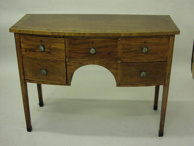 A Regency mahogany and crossbanded bowfront sideboard,