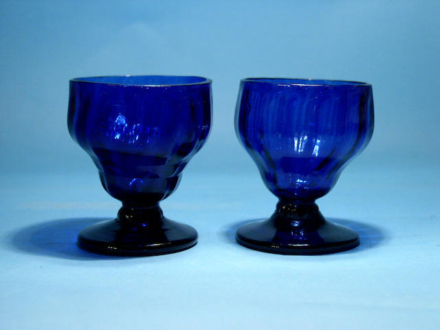A pair of blue glass bonnet glasses, circa 1820,