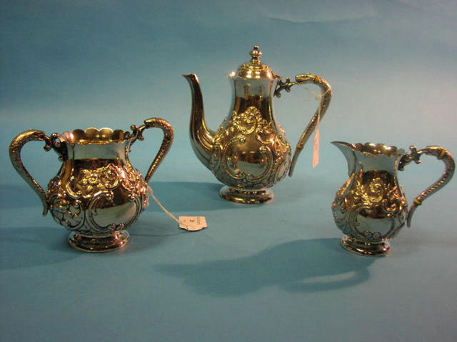 A white metal three piece bachelors teaset
