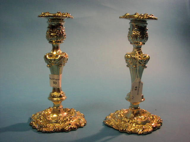 A pair of George IV candlesticks, Sheffield 1824,