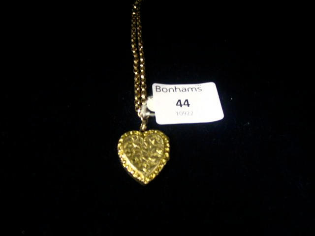 A Victorian 9ct guard chain and locket