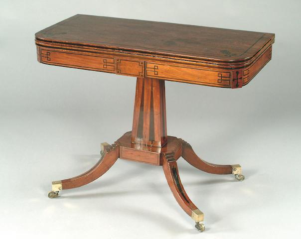 A Regency mahogany and ebony inlaid card table,
