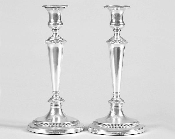 A pair of George III candlesticks John  Roberts & Co, Sheffield 1806,