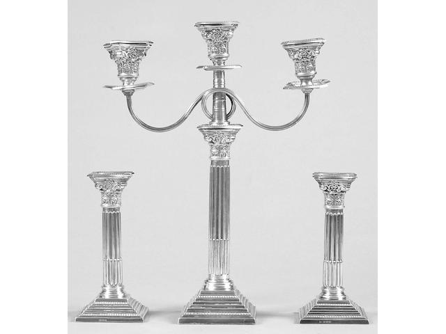 A matched candelstick and three light candelabra set the former makers mark worn, Birmingham 1959/60, the latter A.T & Son, 1961,