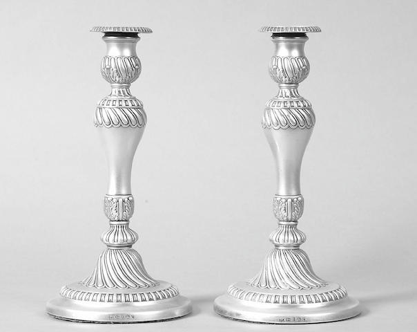 A pair of George III candelsticks  Smith, Tate & Co, Sheffield 1811,