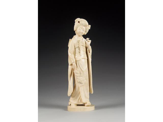 A very fine ivory okimono of a standing Geiko,