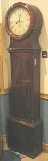 An early 19th Century mahogany drumhead Longcase Clock,