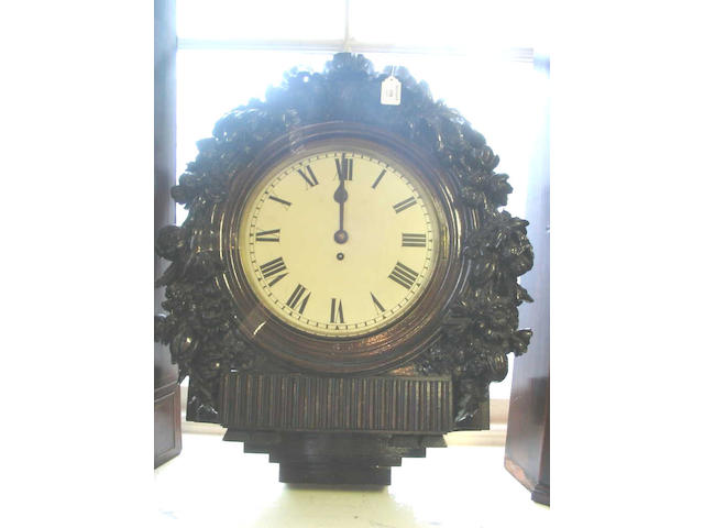 A late 19th Century carved mahogany wall Timepiece,