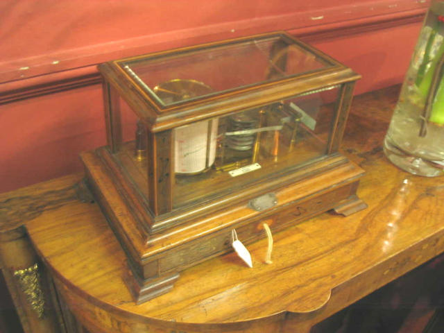 An early 20th Century oak and inlaid cased Barograph,