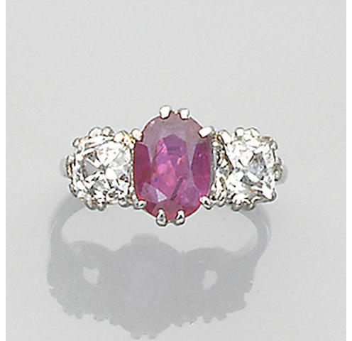 A diamond and ruby three stone ring