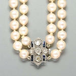 A cultured pearl necklace with a sapphire and diamond clasp,