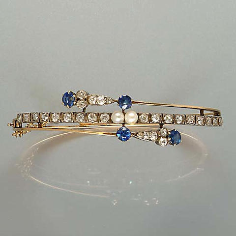 A late Victorian diamond, sapphire and pearl hinged bangle,