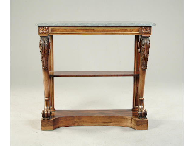 A Regency rosewood and parcel gilt console table, on acanthus carved scroll supports with grey marbl