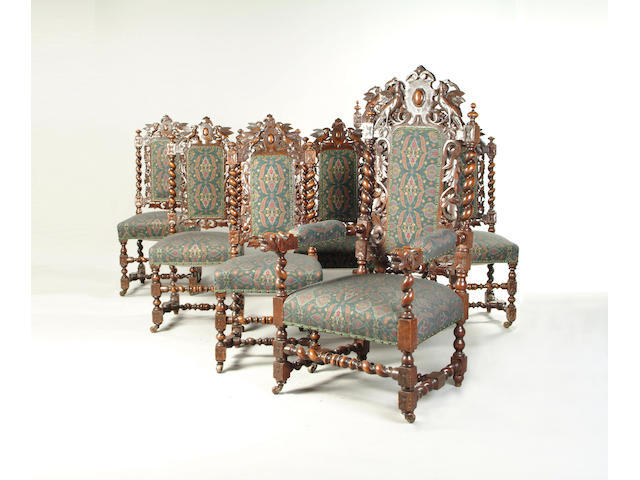 A set of eight late 19th century carved oak dining chairs