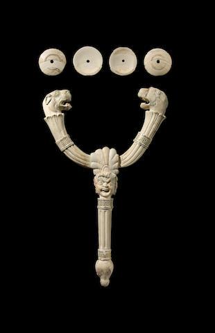 A Greek ivory sistrum inlaid