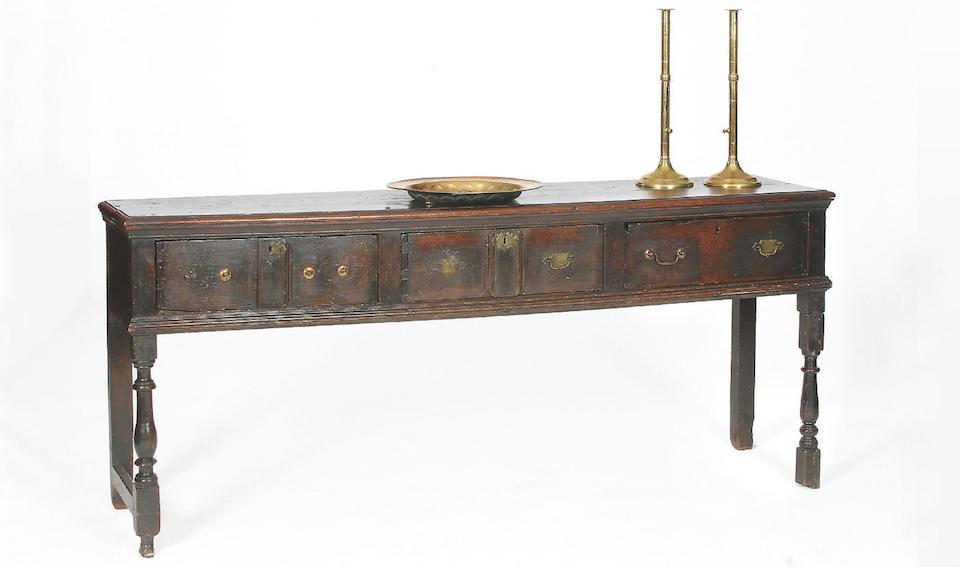 A late 17th Century oak low dresser,