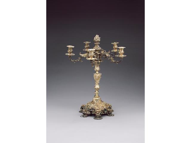 A Paul Storr silver gilt candelabrum
