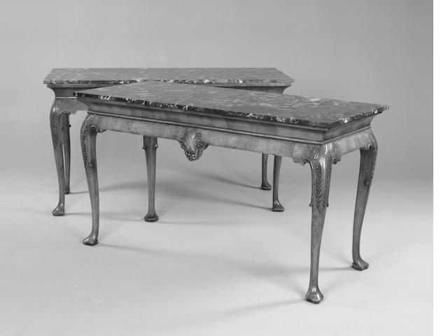 A pair of George II style walnut and marble topped side tables (2)