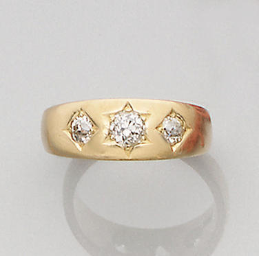 A late Victorian gold and diamond three-stone ring,