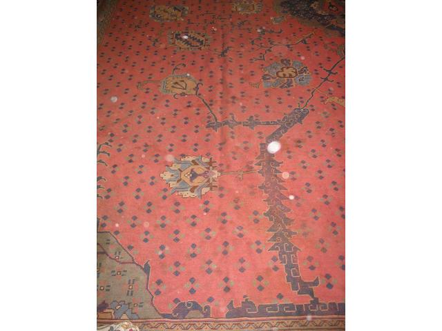 A large Ushak carpet West Anatolia, 803cm x 530cm