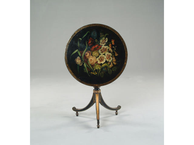 An early 19th century papier maché ebonised gilt and polychrome decorated occasional table