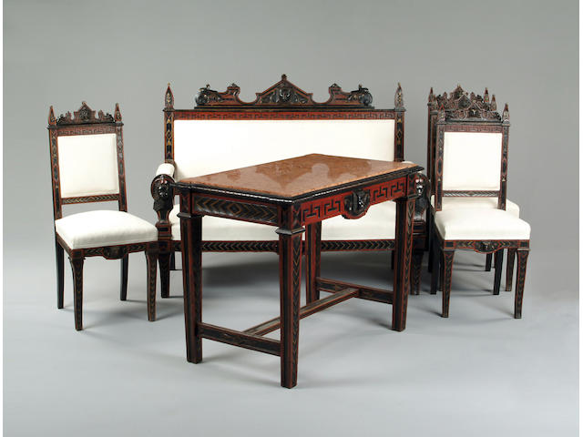An Egyptian revival carved and ebonised salon suite