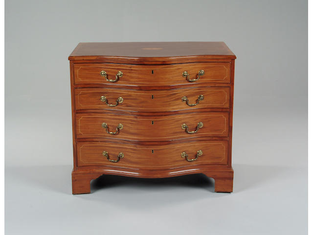 A George III serpentine chest