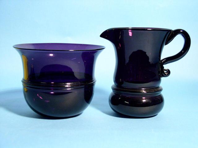 Two amethyst finger bowls, circa 1830, and a water jug (3)