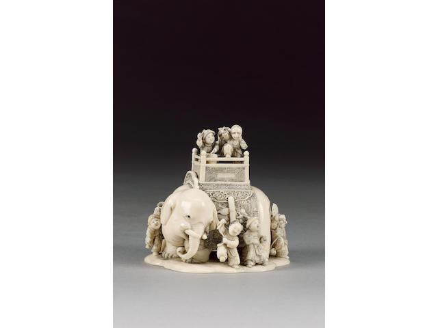 An elegant ivory okimono,