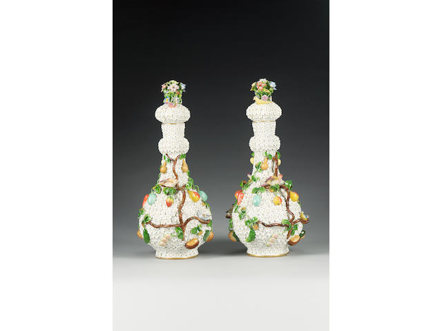 A pair of German porcelain Schneeballen bottle vases and covers, late 19th century,