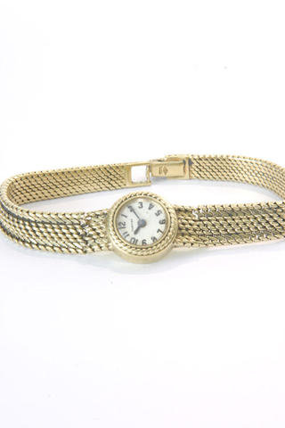 Cartier. An 18ct gold lady's backwind bracelet watch Case No.8767, 701888, London import mark for 1959