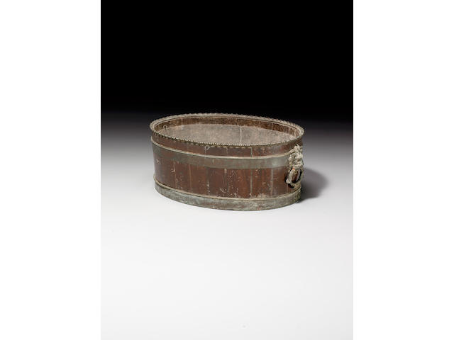 A George III bronze mounted mahogany oval wine cooler