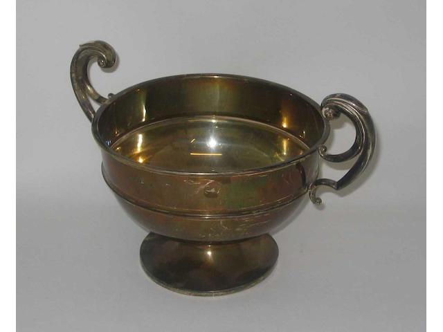 A twin handled trophy bowl, by H. C. Davis, Birmingham, 1922,