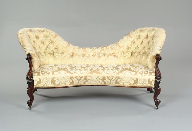 A Victorian mahogany framed double spoon sofa