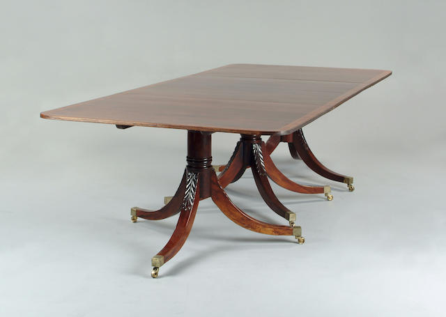 A George III style mahogany triple pedestal dining table