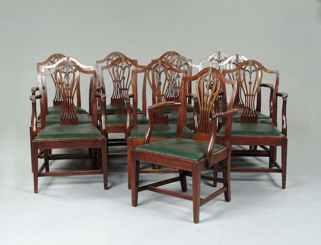 A set of twelve George III mahogany dining chairs
