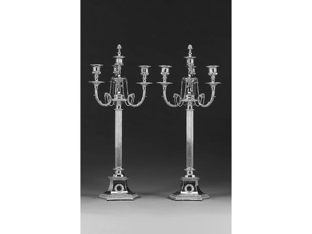 An electroplated pair of four-light candelabra, unmarked,