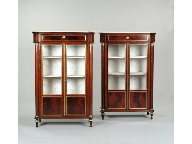 A pair of Directoire mahogany and brass mounted display cabinets