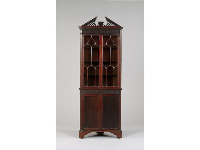 A mahogany Chippendale revival corner display cabinet
