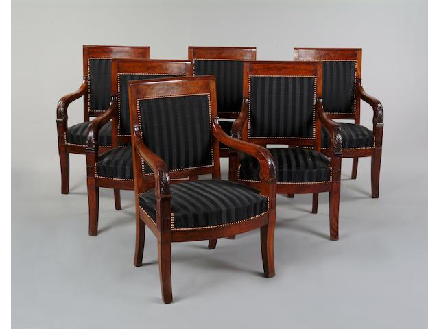 A set of six Empire style mahogany open armchairs